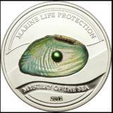 Жемчужина Загадки моря — 2012 — Палау — серебряная монета с  жемчужиной